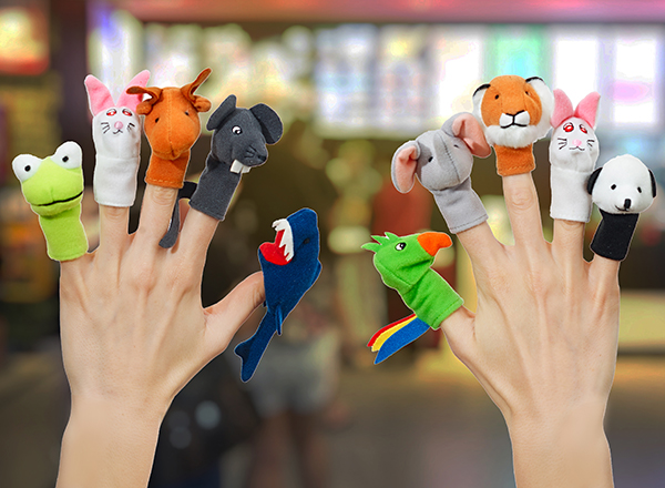 close-up of woman's hands wearing 10 finger puppets