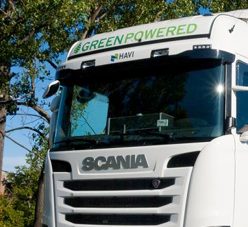 green-powered truck on country road