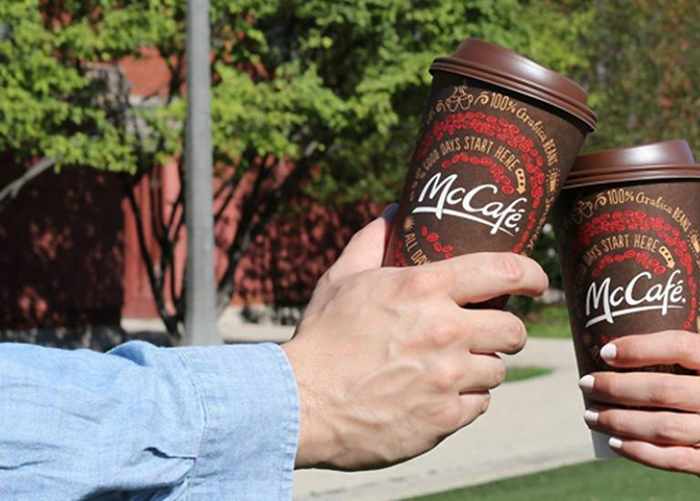 People toasting with Double-walled McCafe Hot Cups
